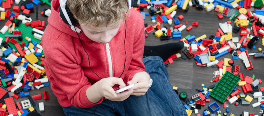 boy-with-iphone-and-legos